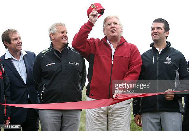 Donald Trump opens The Trump International Golf Links Course as George O'Grady Colin Montgomerie and Don Trump Jr look on on July 10 2012 in Balmedie...