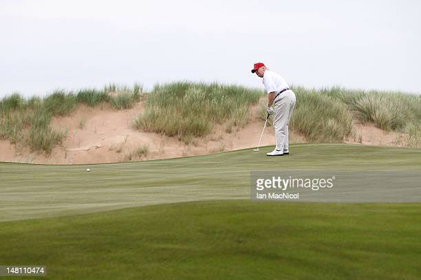 Donald Trump plays a round of golf after the opening of The Trump International Golf Links Course on July 10 2012 in Balmedie Scotland The...