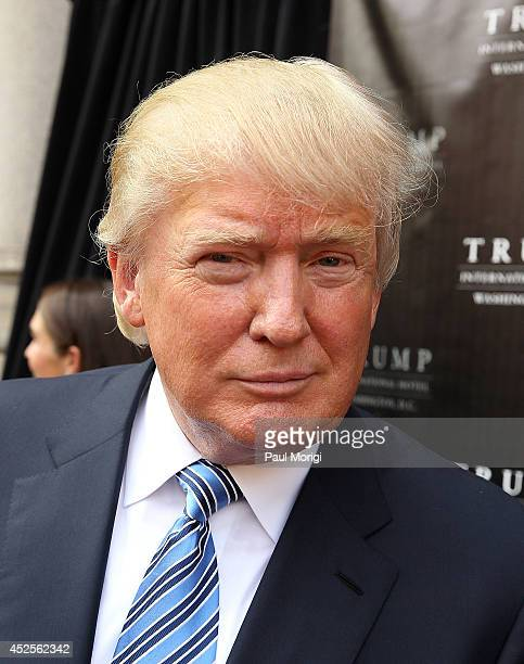Donald Trump poses for a photo at the Trump International Hotel Washington DC Groundbreaking Ceremony at Old Post Office on July 23 2014 in...