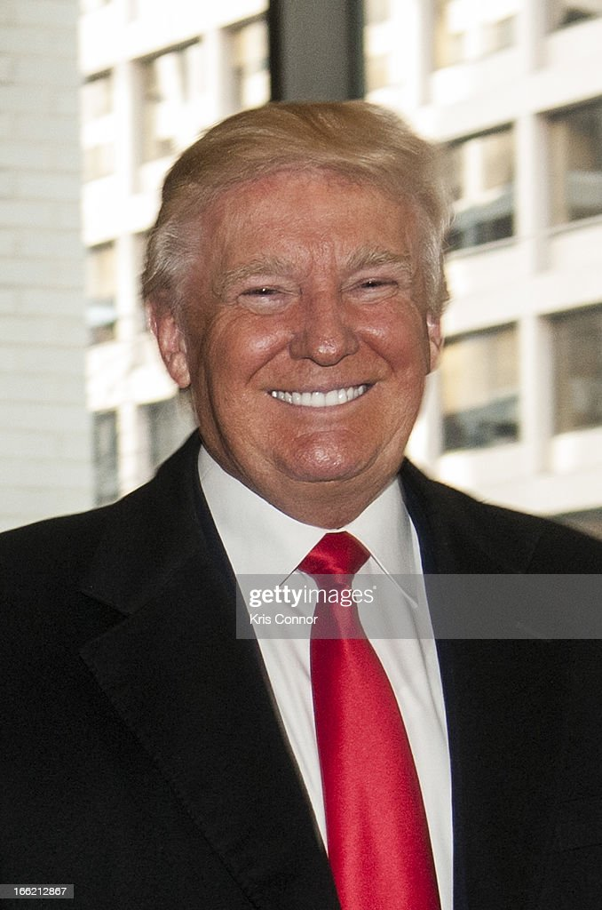 <a gi-track='captionPersonalityLinkClicked' href=/galleries/search?phrase=Donald+Trump+-+Born+1946&family=editorial&specificpeople=118600 ng-click='$event.stopPropagation()'>Donald Trump</a> poses for a photo during a forum on 'Washington real estate -- including plans to renovate the landmark Old Post Office on Pennsylvania Avenue and views on property values and trends in Washington.' at Washington Post on April 10, 2013 in Washington, DC.