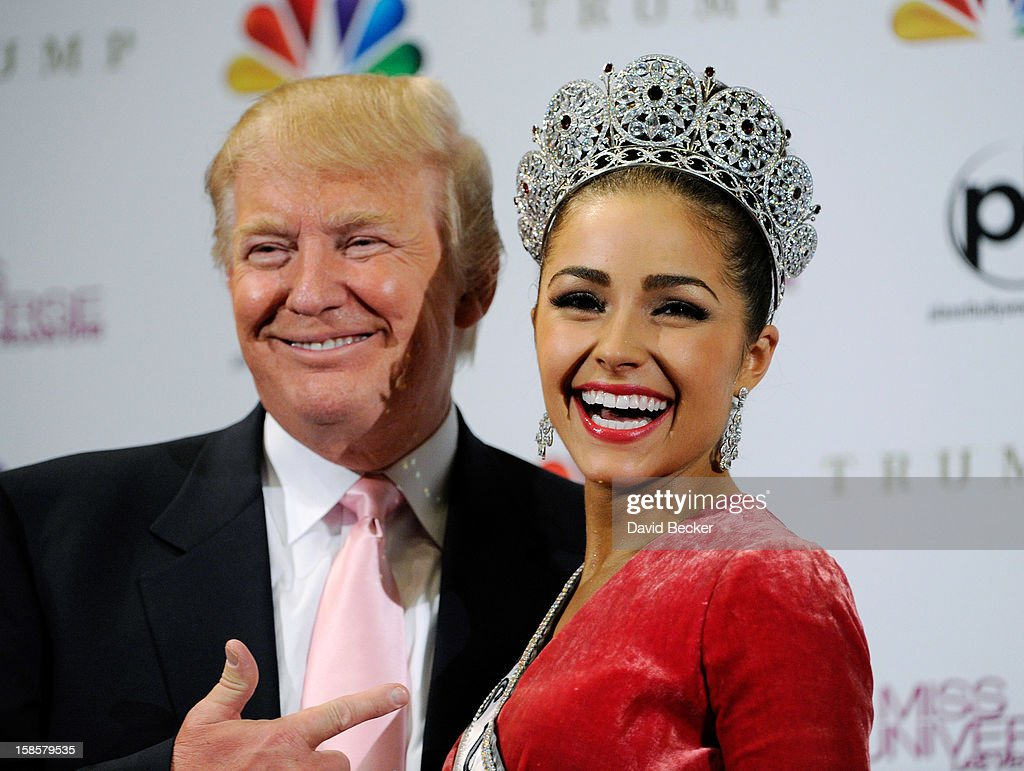 Donald Trump (L) poses with Miss USA 2012, Olivia Culpo, at a news conference after she was named the new Miss Universe during the 2012 Miss Universe Pageant at PH Live at Planet Hollywood Resort & Casino on December 19, 2012 in Las Vegas, Nevada.