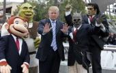 Donald Trump poses with Universal Studio characters at the Universal Studios Hollywood Apprentice Casting Call on March 10 2006 in Universal City...