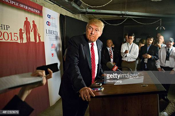 Donald Trump president and chief executive of Trump Organization Inc and 2016 US presidential candidate listens to questions during a press...