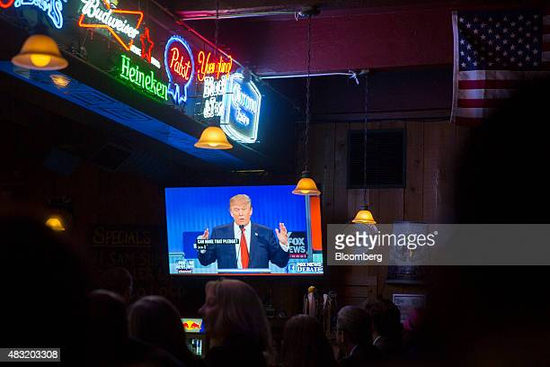 Donald Trump president and chief executive of Trump Organization Inc and 2016 Republican presidential candidate is seen on a television screen in the...