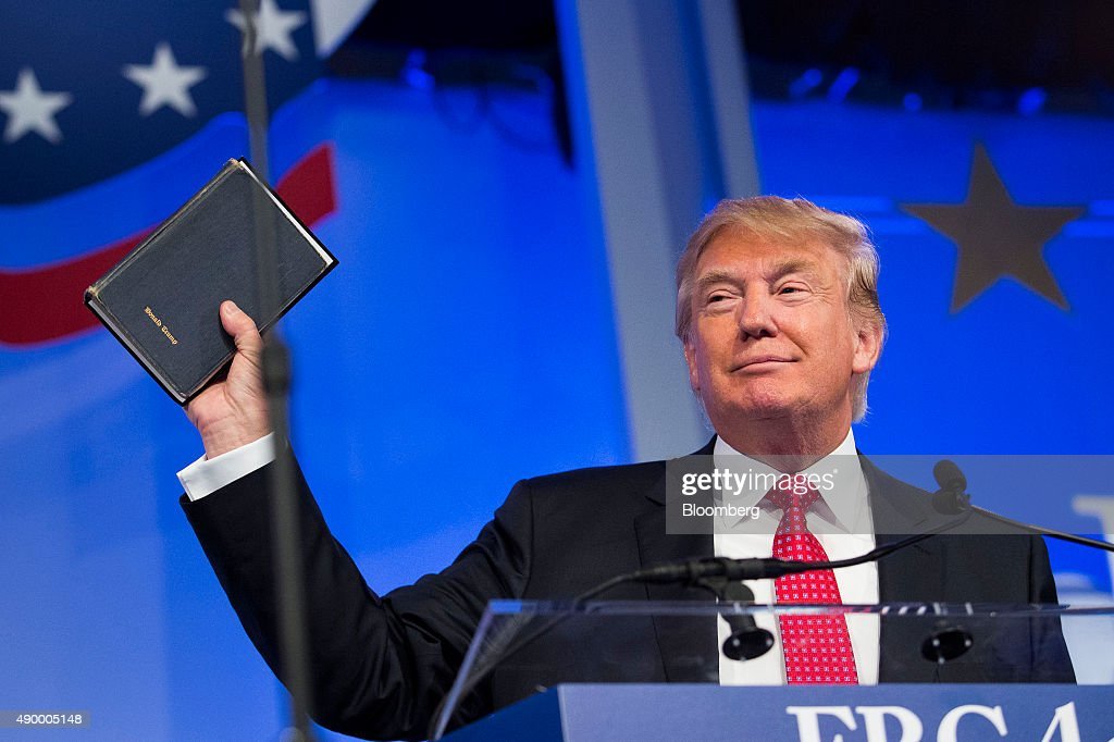 Donald Trump president and chief executive of Trump Organization Inc and 2016 Republican presidential candidate holds up a Bible while speaking at...