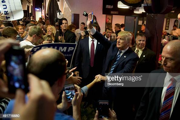 Donald Trump president and chief executive of Trump Organization Inc and 2016 Republican presidential candidate greets attendees after speaking at a...