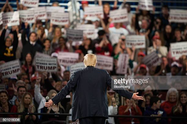 Donald Trump president and chief executive of Trump Organization Inc and 2016 Republican presidential candidate listens to the crowd cheer during a...