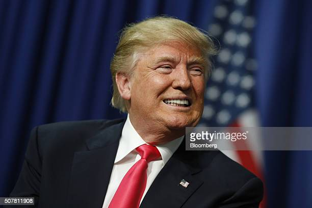 Donald Trump president and chief executive of Trump Organization Inc and 2016 Republican presidential candidate smiles during a campaign rally at the...