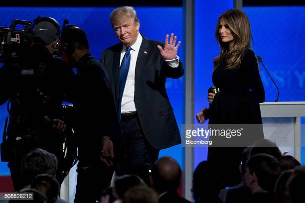 Donald Trump president and chief executive of Trump Organization Inc and 2016 Republican presidential candidate waves to the audience next to his...