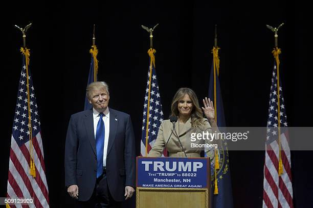 Donald Trump president and chief executive of Trump Organization Inc and 2016 Republican presidential candidate smiles as wife Melania Trump greets...