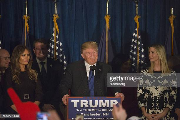 Donald Trump president and chief executive of Trump Organization Inc and 2016 Republican presidential candidate center smiles as wife Melania Trump...