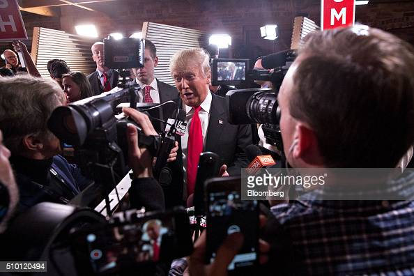 Donald Trump president and chief executive of Trump Organization Inc and 2016 Republican presidential candidate center speaks to the media in the...