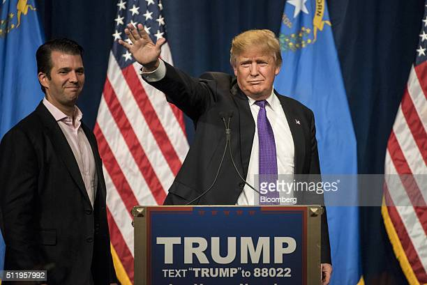 Donald Trump president and chief executive of Trump Organization Inc and 2016 Republican presidential candidate right waves as his son Donald Trump...