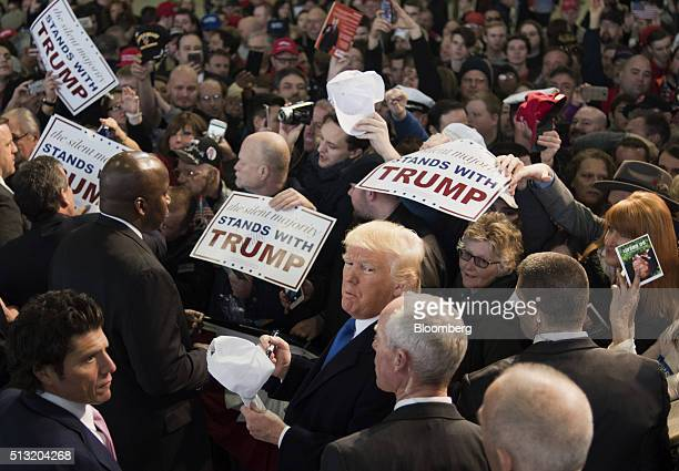 Donald Trump president and chief executive of Trump Organization Inc and 2016 Republican presidential candidate center greets attendees after...