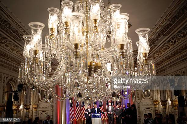 Donald Trump president and chief executive of Trump Organization Inc and 2016 Republican presidential candidate center speaks on stage with Chris...