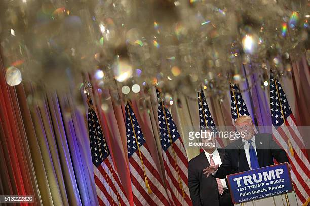 Donald Trump president and chief executive of Trump Organization Inc and 2016 Republican presidential candidate right speaks on stage with Chris...