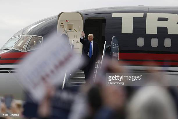 Donald Trump president and chief executive of Trump Organization Inc and 2016 Republican presidential candidate waves to attendees will disembarking...