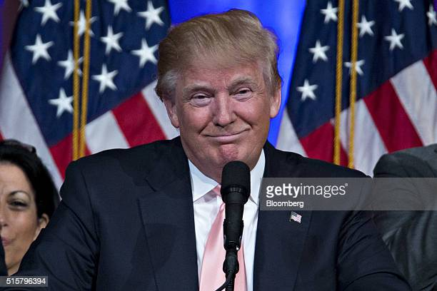 Donald Trump president and chief executive of Trump Organization Inc and 2016 Republican presidential candidate smiles while speaking during a news...