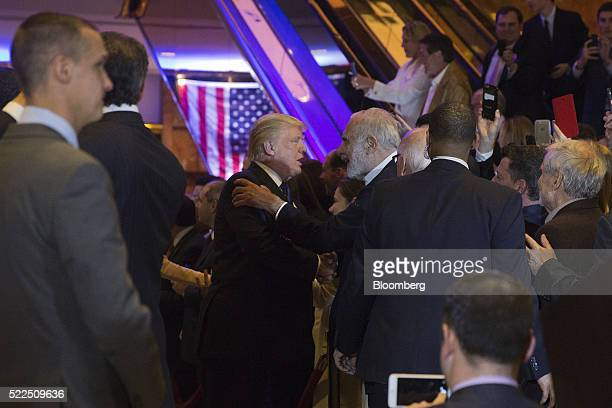 Donald Trump president and chief executive of Trump Organization Inc and 2016 Republican presidential candidate center left greets Carl Icahn...