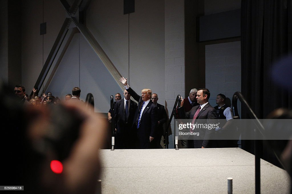 Donald Trump, president and chief executive of Trump Organization Inc. and 2016 Republican presidential candidate, waves to attendees in an overflow room during a campaign event in Evansville, Indiana, U.S., on Thursday, April 28, 2016. Trump said he's campaigning hard to win Tuesday's presidential primary in Indiana and that if he prevails, his party's nomination contest will be 'over.' Photographer: Luke Sharrett/Bloomberg via Getty Images