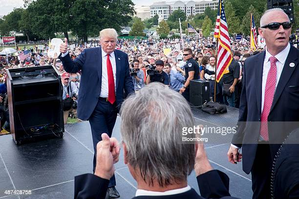 Donald Trump president and chief executive officer of Trump Organization Inc and 2016 Republican presidential candidate gives a thumbs up after...