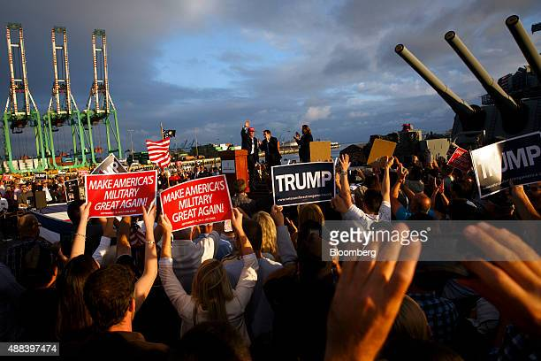 Donald Trump president and chief executive officer of Trump Organization Inc and 2016 Republican presidential candidate waves to the crowd during a...