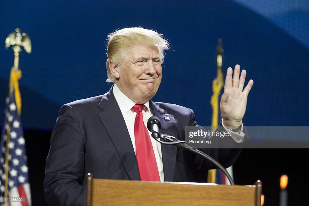Donald Trump, presumptive Republican presidential nominee, waves while speaking during the Western Conservative Summit in Denver, Colorado, U.S., on Friday, July 1, 2016. Trump is looking to project party unity in the Hamptons next week, when he'll huddle with Republican National Committee Chairman Reince Priebus at a fundraiser featuring top donors to some of his former rivals. Photographer: Matthew Staver/Bloomberg via Getty Images
