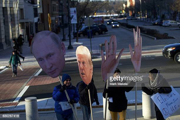 Donald Trump protestors holding cardboard cutouts of the Presidentelect and Russian President Vladimir Putin join a demonstration outside the...