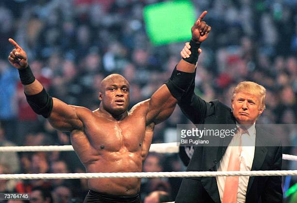 Donald Trump raises the hand of WWE wrestler Bobby Lashley in victory after Lashley defeated Umaga in the Battle of the Billionaires at the 2007...