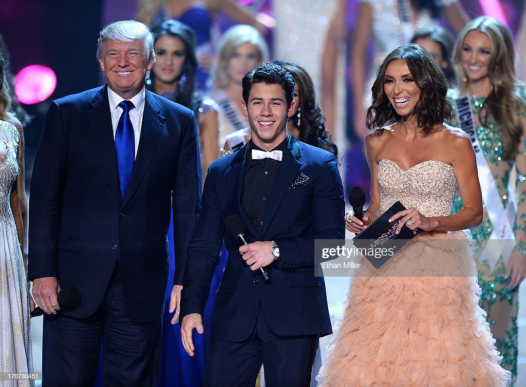 Donald Trump, recording artist and host Nick Jonas and television personality and host Giuliana Rancic appear onstage during the 2013 Miss USA pageant at PH Live at Planet Hollywood Resort & Casino on June 16, 2013 in Las Vegas, Nevada.