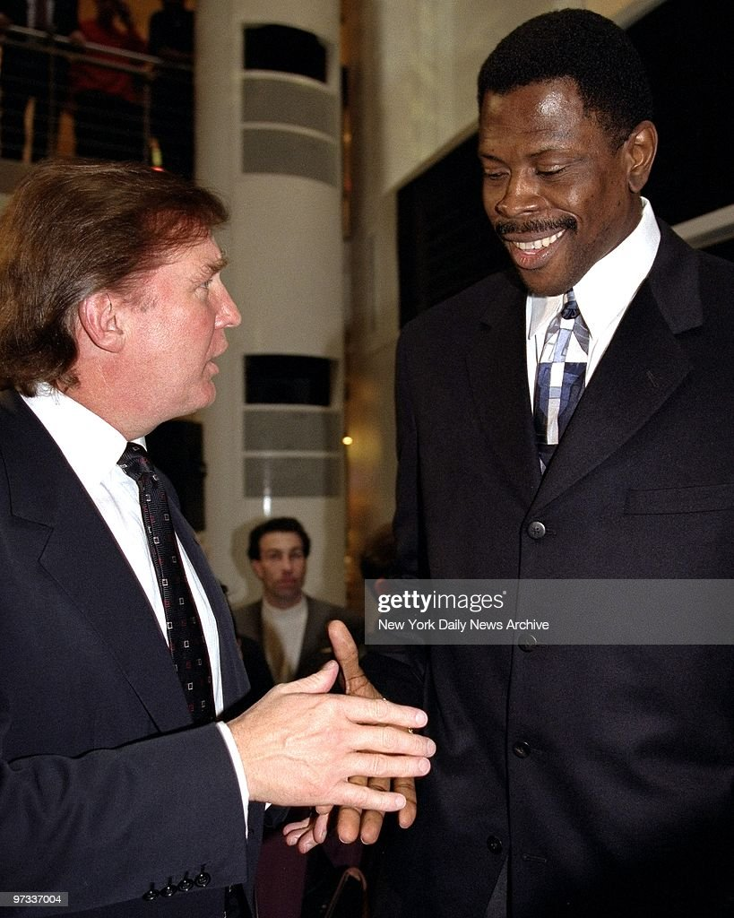 Donald Trump shakes hands with Patrick Ewing at the opening of the new Nike Town store on E. 57th Street in New York City.