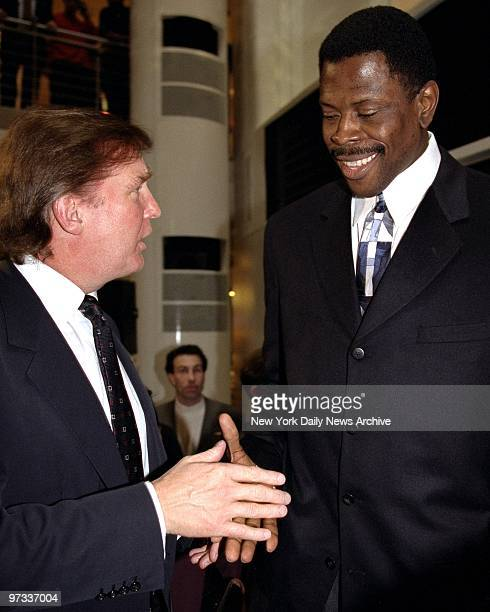 Donald Trump shakes hands with Patrick Ewing at the opening of the new Nike Town store on E 57th Street in New York City