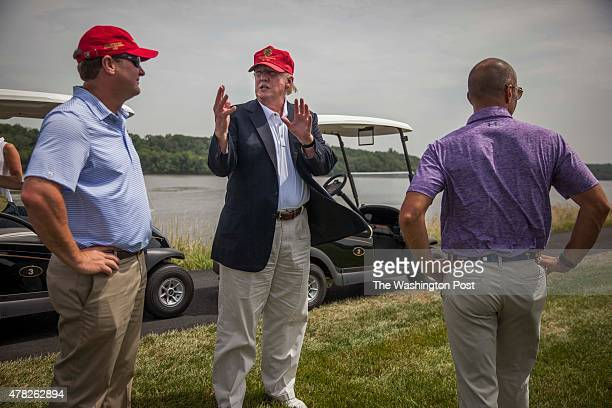 Donald Trump shows off his course to David Charles and Pete Bevacqua of PGA America at the opening of his championship golf course in Sterling VA...