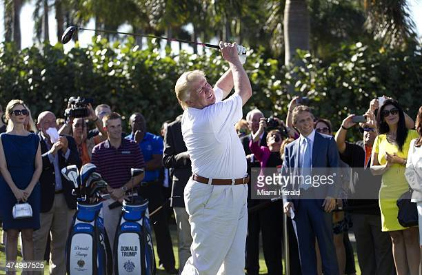 Donald Trump shows off his updated golf course by hitting a ceremonial tee shot off the first tee at Trump National Doral Feb 6 in Doral Fla