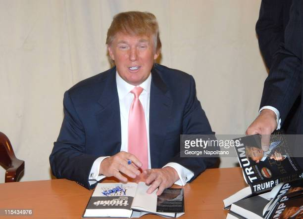 Donald Trump signs a copy of his new book 'Think Big and Kick Ass' at Barnes Noble on 5th avenue in New York City on October 16 2007