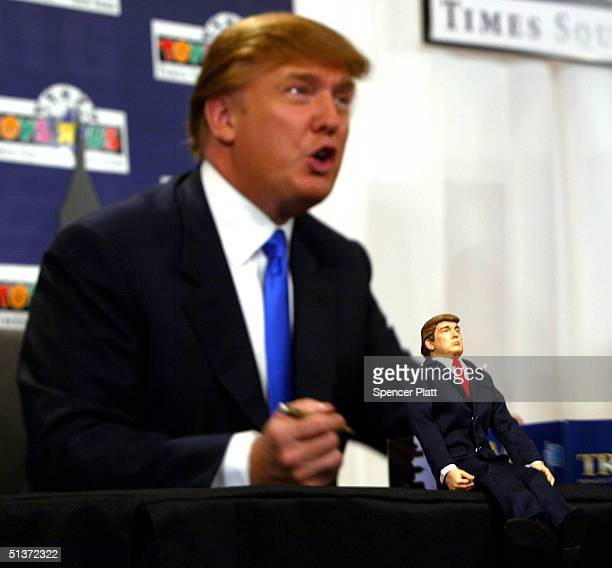 Donald Trump signs autographs for his new Donald Trump 12inch talking doll September 29 2004 at the Toys 'R' Us store in New York City The doll's...