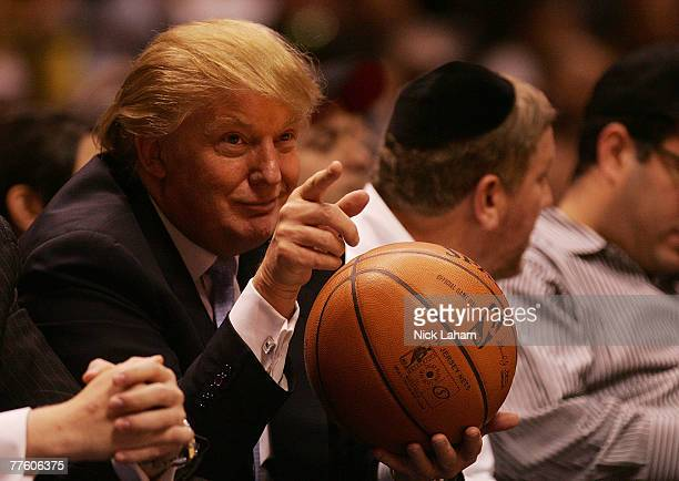 Donald Trump sits courtside at the New Jersey Nets and the Chicago Bulls game at the Izod Center on October 31 2007 in East Rutherford New Jersey...