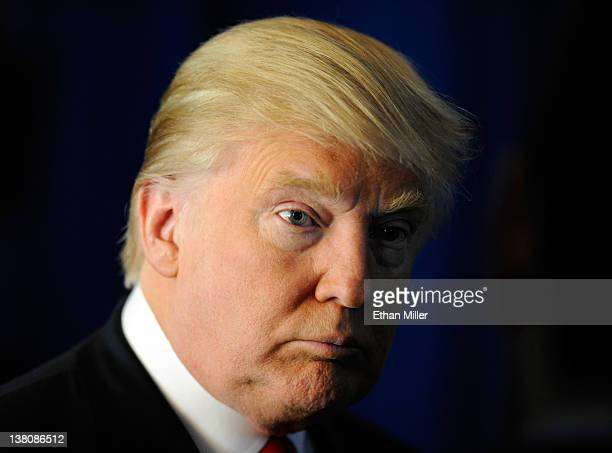 Donald Trump speaks to members of the media before endorsing Republican presidential candidate former Massachusetts Gov Mitt Romney at the Trump...