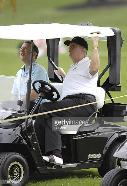 Donald Trump strains to watch the action during the first round of the ADT Championship at the Trump International Golf Club in West Palm Beach...