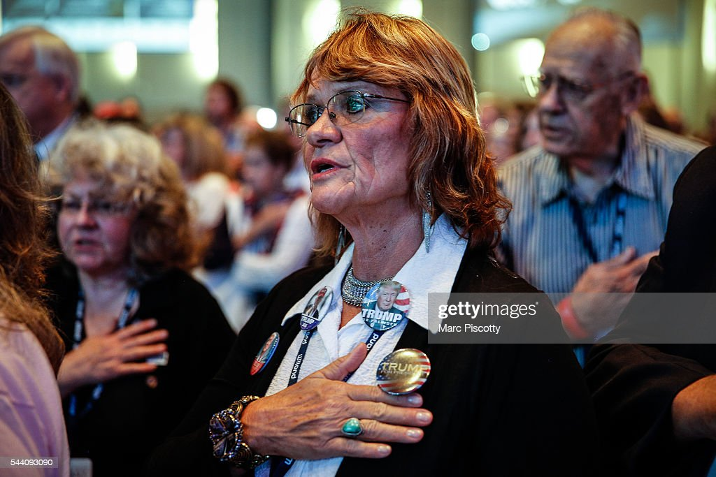 Donald Trump supporter Anna Heintzelman of Colorado Springs, Colorado participates in the Pledge of Allegiance while the crowd waits for Trump to speak at the 2016 Western Conservative Summit at the Colorado Convention Center on July 1, 2016 in Denver, Colorado. The Summit, being held July 1-3, is expected to attract more than 4,000 attendees.
