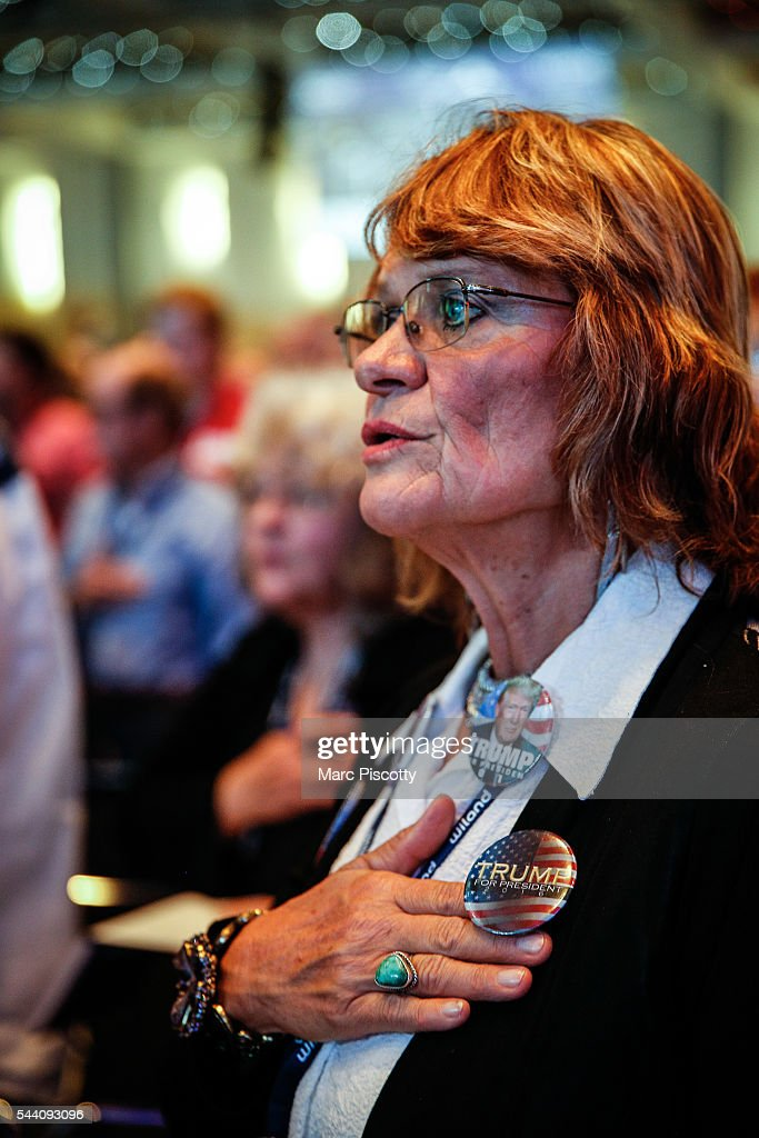 Donald Trump supporter Anna Heintzelman of Colorado Springs, Colorado participates in the Pledge of Allegiance while waiting for Trump to speak at the 2016 Western Conservative Summit at the Colorado Convention Center on July 1, 2016 in Denver, Colorado. The Summit, being held July 1-3, is expected to attract more than 4,000 attendees.