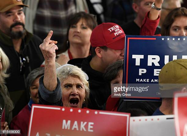 A Donald Trump supporter show her disapproval of the media after GOP Presidential candidate Donald Trump left the stage at the Norris Penrose...