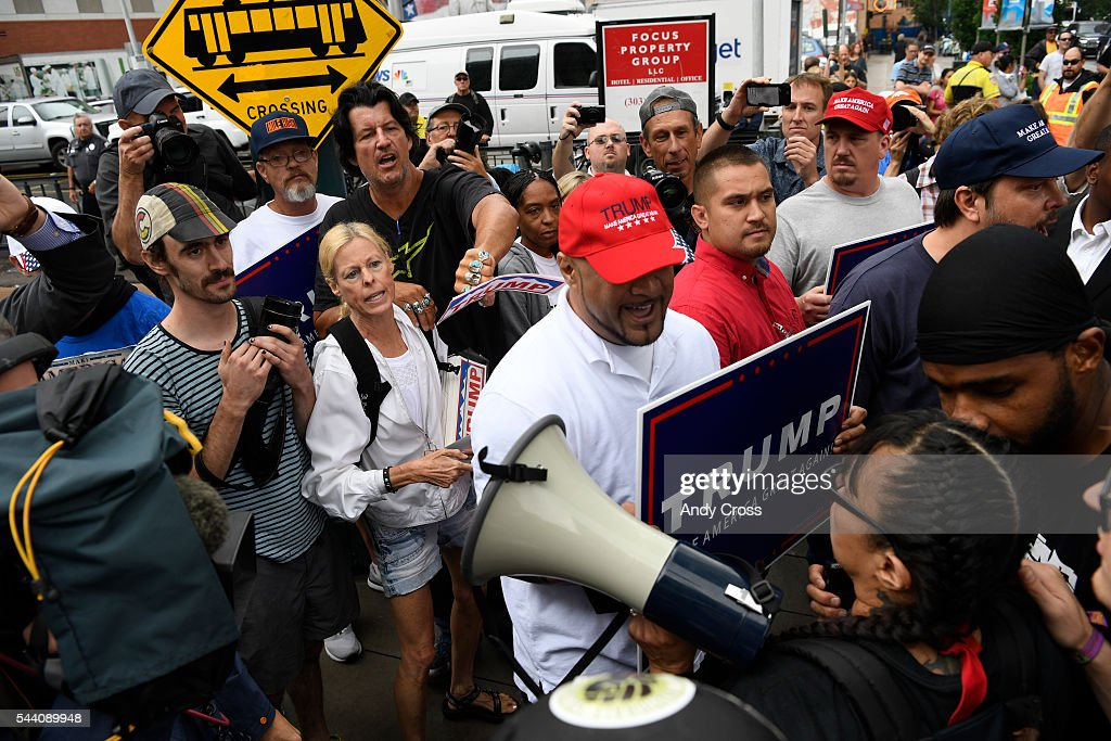Donald Trump supporters and anti-Trump protesters argue at the intersection of 14th and California, in front of the Colorado Convention Center where Mr. Trump was speaking July 01, 2016. The Trump supporter and a protester were detained after the incident.