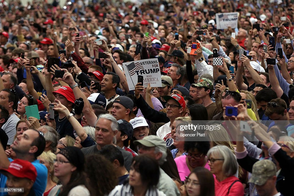 Donald Trump supporters listen to the presumptive Republican presidential candidate speak at a rally in San Diego on May 27, 2016 in San Diego, California. Trump is on a Western campaign trip which saw stops in North Dakota and Montana yesterday and two more in California today.