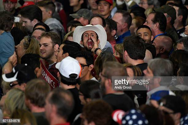 Donald Trump supporters show their distrust of the media after Trump mentioned the media at the Stadium Arena at the National Western Stock Show...