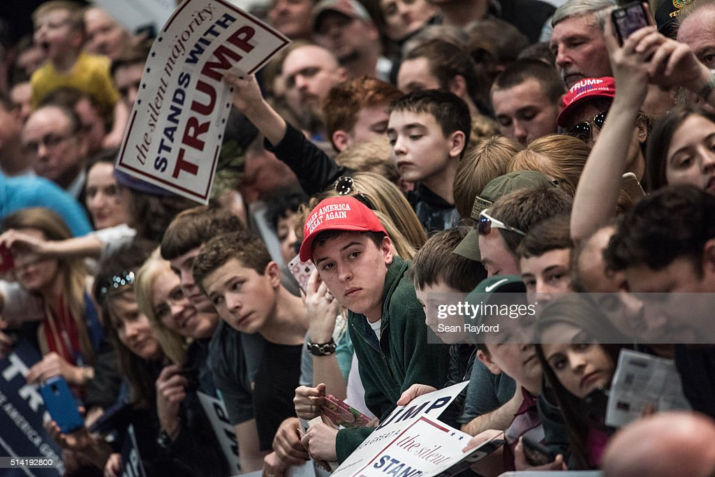 Donald Trump supporters wait for autographs from the Republican presidential candidate at a campaign rally March 7 2016 in Concord North Carolina The...
