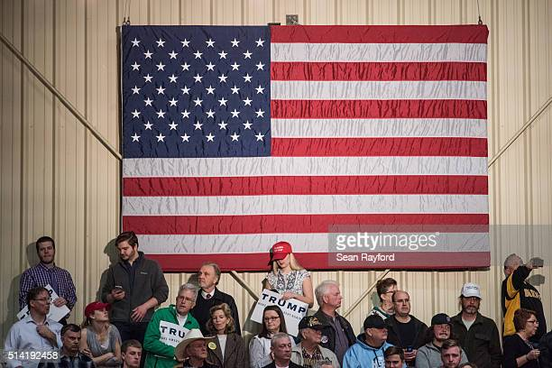 Donald Trump supporters wait for the arrival of the Republican presidential candidate at a campaign rally March 7 2016 in Concord North Carolina The...