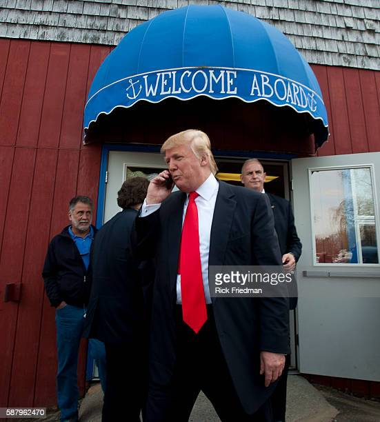 Donald Trump talking on his phone outside Newick's Lobster House while campaigning in Dover NH on April 27 2011