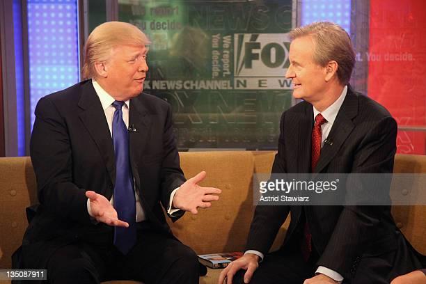 Donald Trump talks with 'FOX Friends' host Steve Doocy at FOX Studios on December 6 2011 in New York City