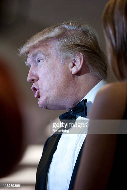 Donald Trump talks with the media at the White House Correspondents' Association dinner in Washington DC US on Saturday April 30 2011 The dinner...